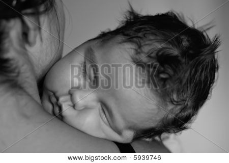 Baby sleeping on moms shoulder