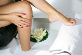 picture of pedicure  - Woman spa pedicure foot treatment with water and flower - JPG