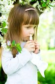picture of nose drops  - Little girl spraying medicine in nose nose drops nose spray - JPG