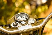 stock photo of khakis  - Vintage khaki motorcycle dashboard close - JPG