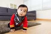 Asian baby boy creeping on floor
