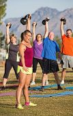 foto of lady boots  - Boot camp exercise class lifting kettle bell weights