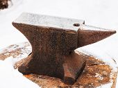 foto of anvil  - anvil in old abandoned village smithy in winter - JPG
