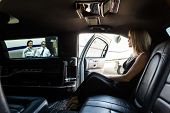 stock photo of terminator  - Elegant woman in limousine with airhostess and pilot near private jet at terminal - JPG