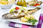 Fish, Sea Bass Grilled With Lemon ,salad And Potatoes