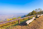 picture of log fence  - old log wood chair with wood fence on view point landscape - JPG