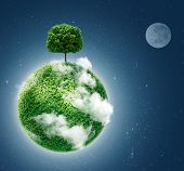Green planet. Ecology concept. Green planet earth with a tree on  background of space . Go green. bl