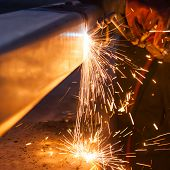 stock photo of pipe-welding  - worker cutting steel pipe using metal torch and install roadside fence - JPG