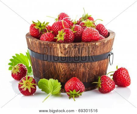 Fresh strawberry in wooden bucket with green leaf. Isolated on white background