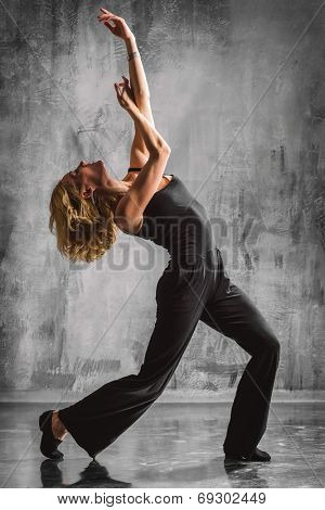 jazz style dancer posing on a studio background