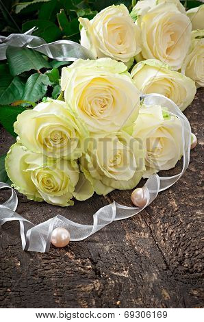 White roses on the wooden backgrounds