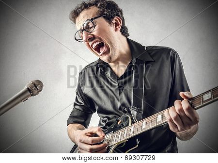 man singing like a rock-star