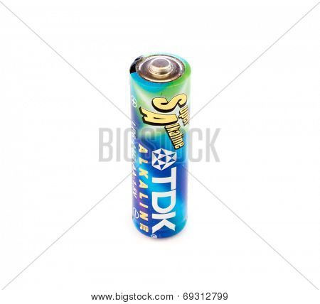 GOMEL, BELARUS - JUNE 22, 2014: TDK AA alkaline battery on a white background. TDK Corporation, is a Japanese multinational electronics company that manufactures electronic materials and components.