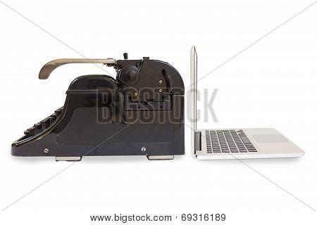 Modern Laptop And Old Typewriter