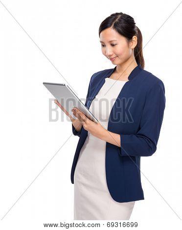 Woman look at digital tablet