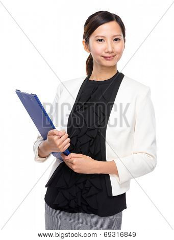 Confident businesswoman with clipboard