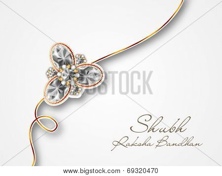 Beautiful diamond decorated rakhi with hindi text Subh Rakhi (Rakhi Wishes) on grey background for Hindu community festival Raksha Bandhan celebrations.