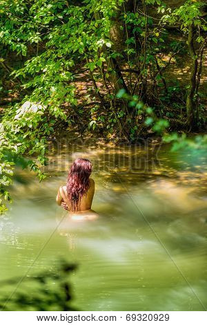 Beautiful Naked Woman Standing In Water
