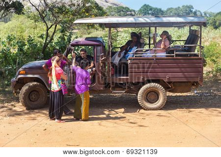 YALA NATIONAL PARK, SRI LANKA - MARCH 4, 2014: Safari jeep tour in the Yala park. Yala is the second largest national park in Sri Lanka.