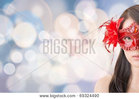 Portrait of Asian young beautiful woman in a carnival mask, closeup portrait.