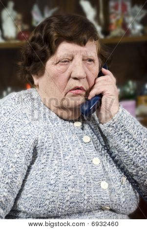 Elderly Woman Speaking At Phone