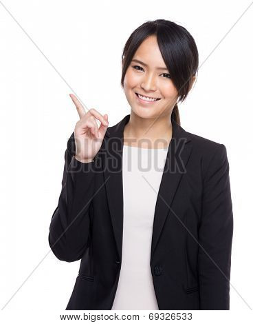 Confident businesswoman finger up
