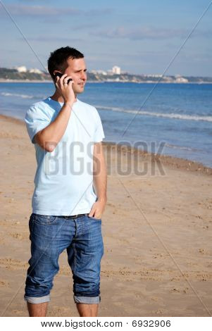 Man with mobile on beach