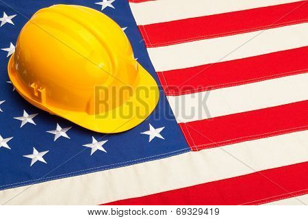 Construction Helmet Laying Over Usa Flag - Studio Shoot