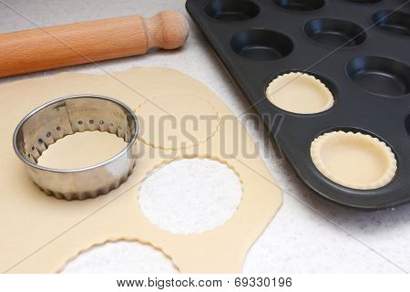 Lining A Bun Tin With Circles Of Rolled Out Pastry