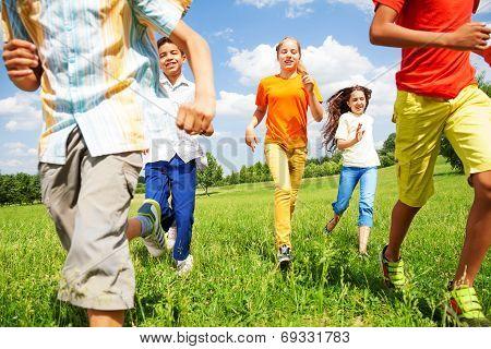 Running children together in motion outside