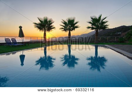 Palm Trees And Pool In An Aegean Sunrise