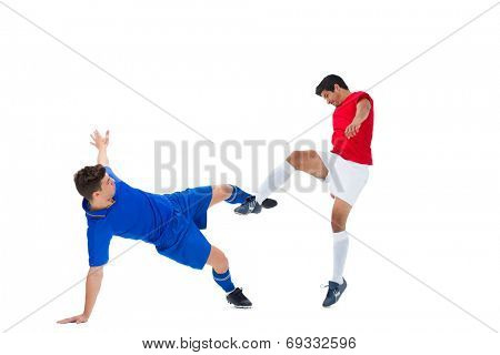 Football players tackling for the ball on white background