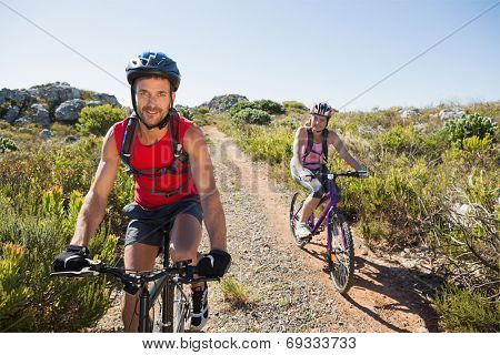 Active couple on a bike ride in the countryside on a sunny day