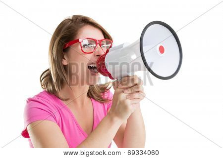 Close up of young woman shouting into bullhorn over white background
