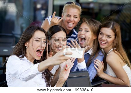 Selfie Five women sitting in a cafe on the street