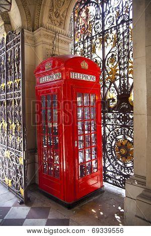 LONDON, UK - JUNE 24, 2014: Phone box in Westminster, red symbol of Great Britain