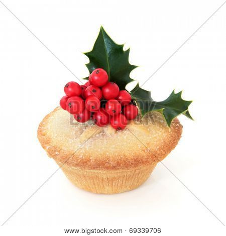 Mince pie with holy berry leaf sprig over white background.