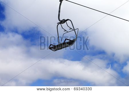 Chair-lift And Blue Sky With Clouds
