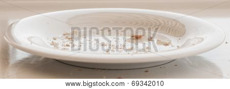 White Plate With Bread Crumbs.