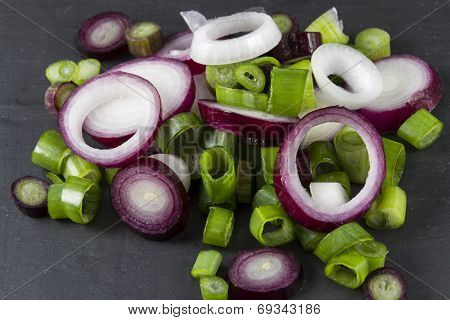 Slices Of Allum Purple And Green Salad Spring Onions, Scallions, Macro.
