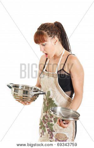 Woman Standing In Studio Looking At Empty Cook Pot