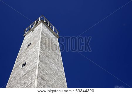 Old Wooden Lighthouse Under Blue Sky