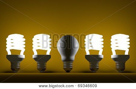 Switched Off Tungsten Light Bulb Among Glowing Spiral Ones