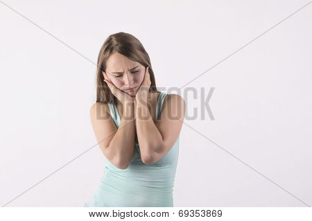 Woman With A Toothache Holding Head