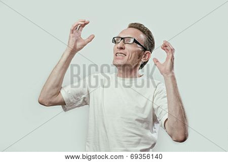Upset man in anger looks left and up his hands