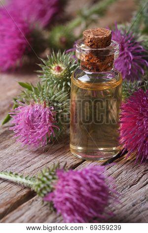 Burdock Oil In A Glass Bottle Macro Vertical
