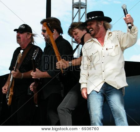 Donnie Van Zant, Don Barnes, Danny Chauncy and Larry Junstrom of 38 Special performing at Celebrate