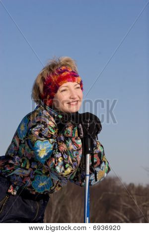 The Young Woman Has Leant Against Ski Sticks