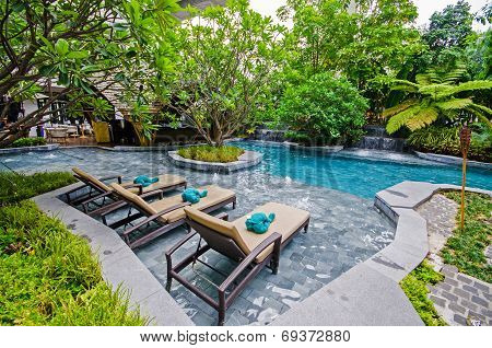Poolside Relax Chairs In Garden Style Swimming Pool