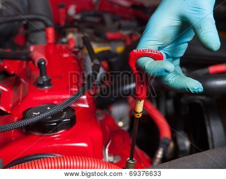 Mechanic Checking The Oil Level In A Engine Car